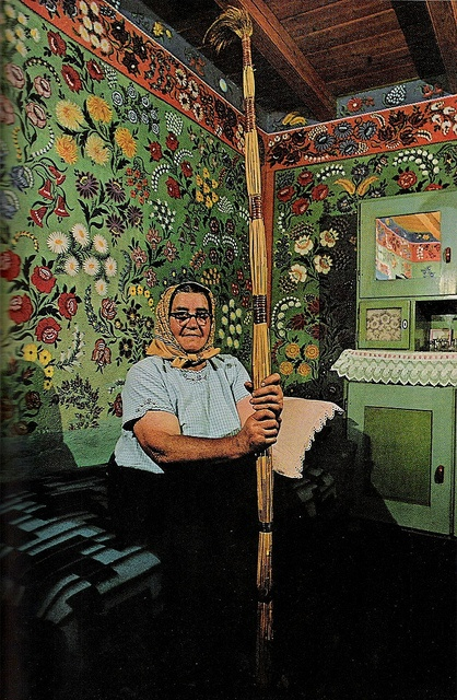 "April 1971 -   ""A whole house for a canvas: Mrs. Lajosne Vargacz sits before a bedroom mural painted with the help of her neighbors at Kalocsa. Such folk art, once common in the region, today has few practitioners. Cane-and-feather duster resembles the long-handled paint brushes the artists used to decorate hard-to-reach heights."" Via Sara Gossett"