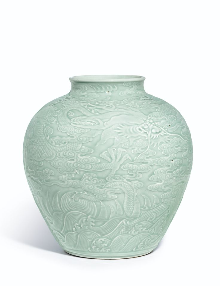 The Fonthill 'Dragon' Jar. A Magnificent Carved Celadon-Glazed 'Dragon' Jar Seal Mark And Period Of Qianlong