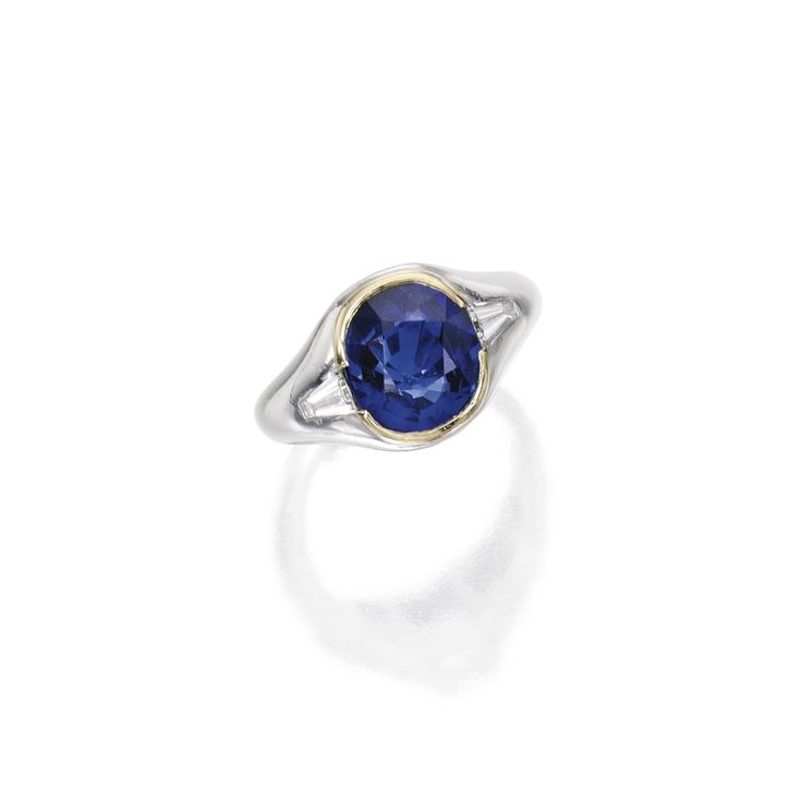 Platinum, 18 Karat Gold, Sapphire and Diamond Ring, Cartier | Lot | Sotheby's