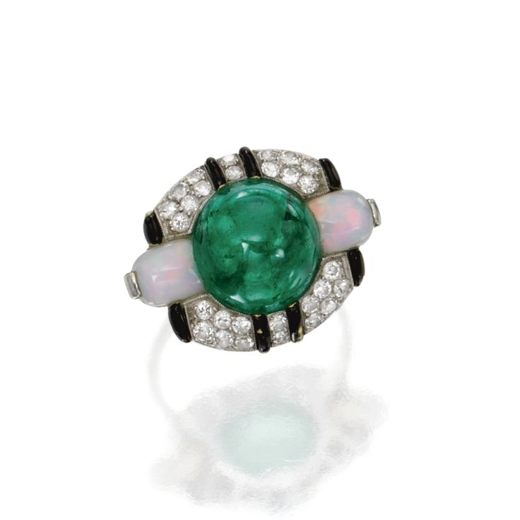 Platinum, emerald, opal, diamond and enamel ring, Georges Fouquet, circa 1920. Photo Sotheby's