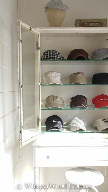 Vintage medical cabinet for hat display storage @WhisperWood Cottage Cottage.