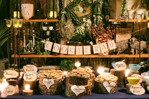Cookie Bar    This charming cookie buffet was styled similarly to an ice cream sundae bar — guests spread Nutella, chocolate frosting, or marshmallow fluff onto their cookies, then added fun toppings like M, Reese's Peanut Butter Cups, Twix, Oreos, and more.    Photo Credit: Abby Rose Photo