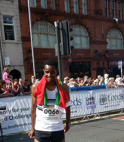Oromo athlete Guddinaa Dabalee, the winner  of run for Leads 10km, UK. 14th July 2013 with Oromia national flag.