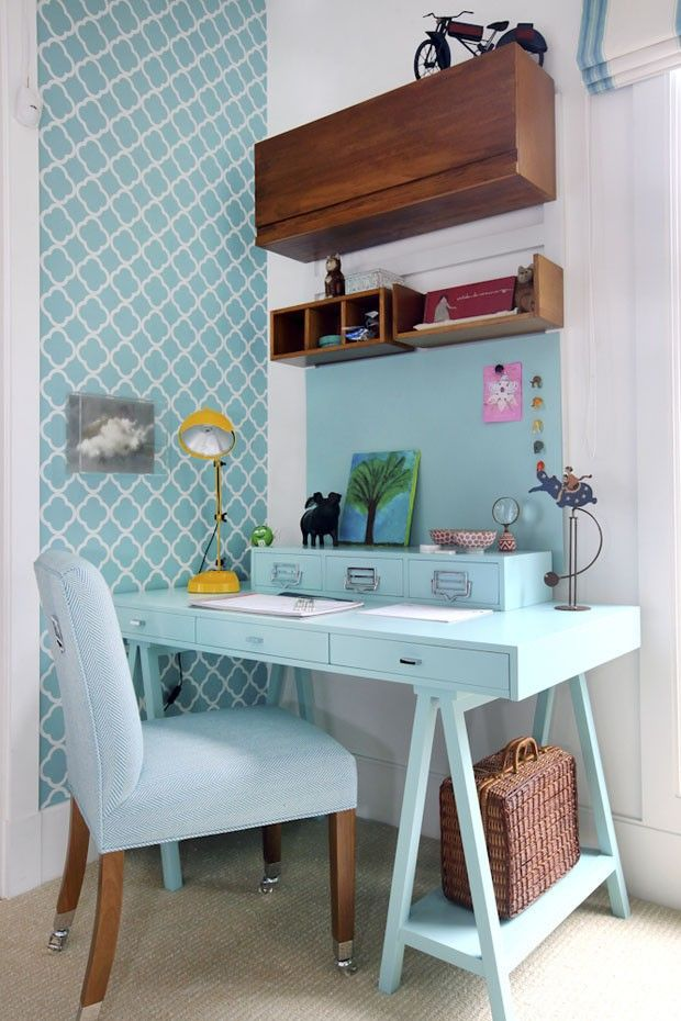 Love the blue desk and contrasting wood shelves in this modern home office nook