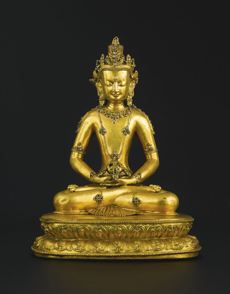 A gilt-bronze and hardstone inlaid figure of Amitayus, Tibet, 14th century