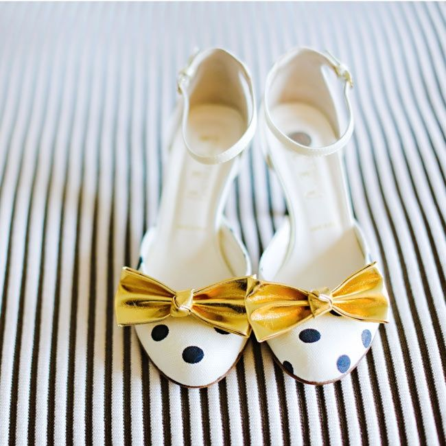 These gold bows are adorable! Polka dot heels from Something Bleu / Photo: Jessica Strickland / TheKnot.com