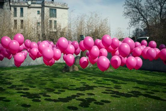Use golf tees to stake balloons to the ground. Awesome for parties/showers. Line the driveway.