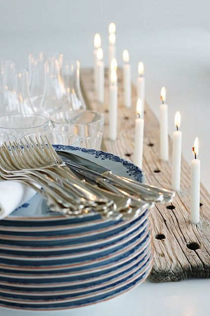 Glowing Candles in a Drilled Wood Slab
