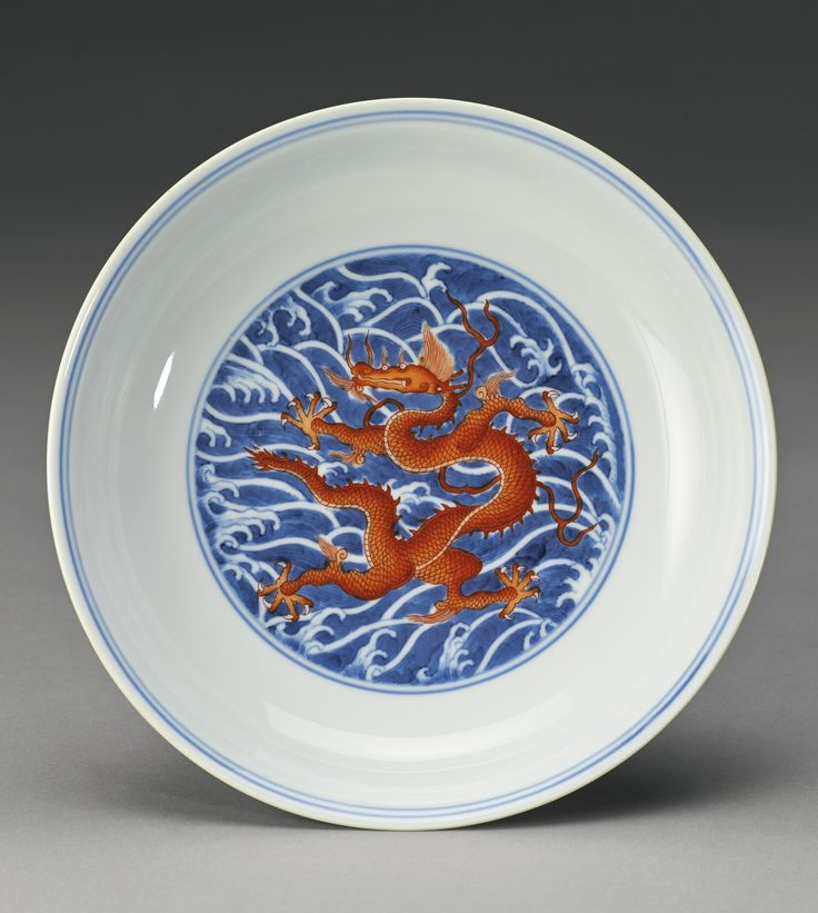 An underglaze blue and iron-red 'Dragon' dish, Qianlong seal mark and period