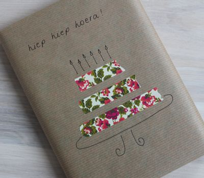 DIY wrapping paper art with brown paper bag, pen, & scrap pieces. Simple & you can add a personalized touch. :)