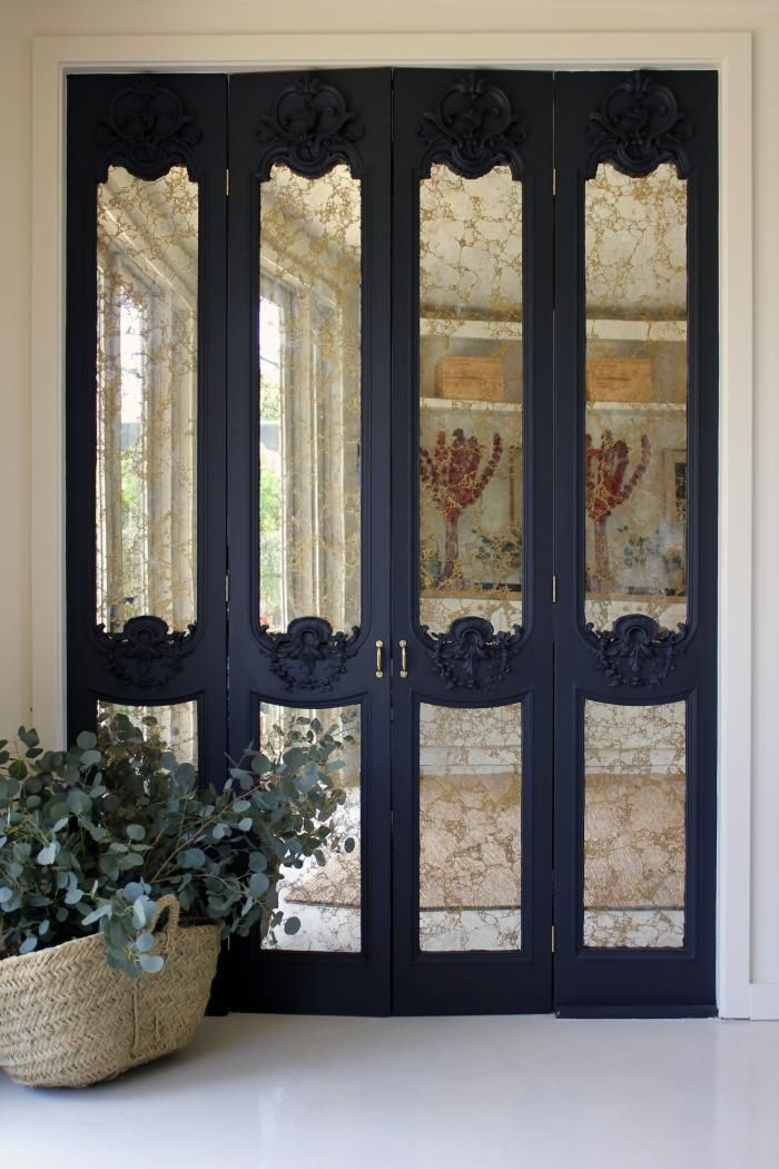 mercury mirrored doors - hmm, use spray paint techinque for faux mrc glass on glass shelving, glass table tops, glass panels for doors......got me thinking now