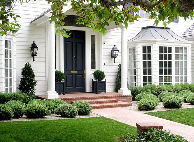 I find white houses with black front doors and herringbone pattern brick porches/walkways quite charming & classic!