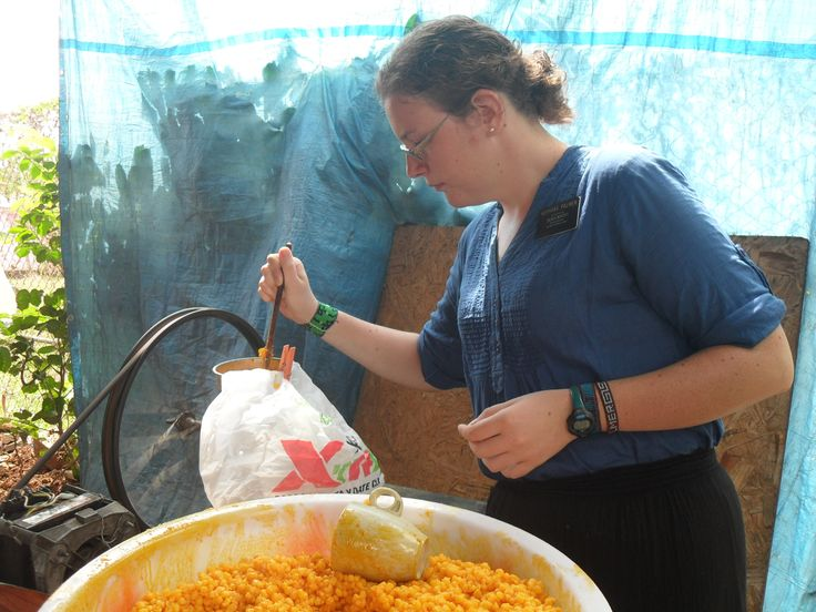 The second is from making tamales. This is me using the machine to grind the corn to make the masá.