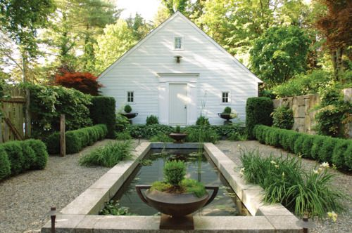 water feature, boxwood & urns