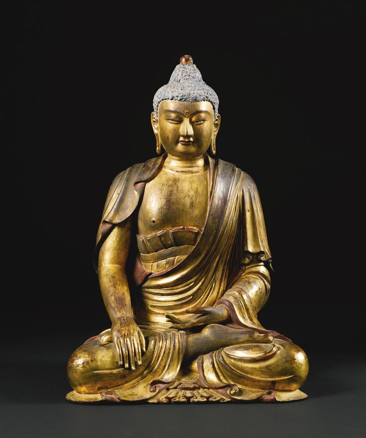 A large gilt-lacquered wood figure of Buddha, China, Qing dynasty, 18th century