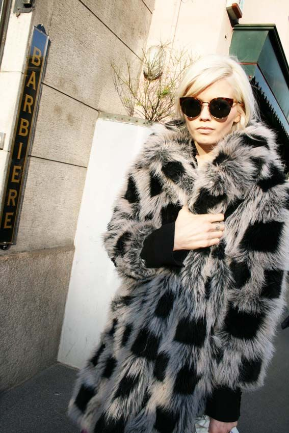 Insane fur coat and cat eye sunglasses
