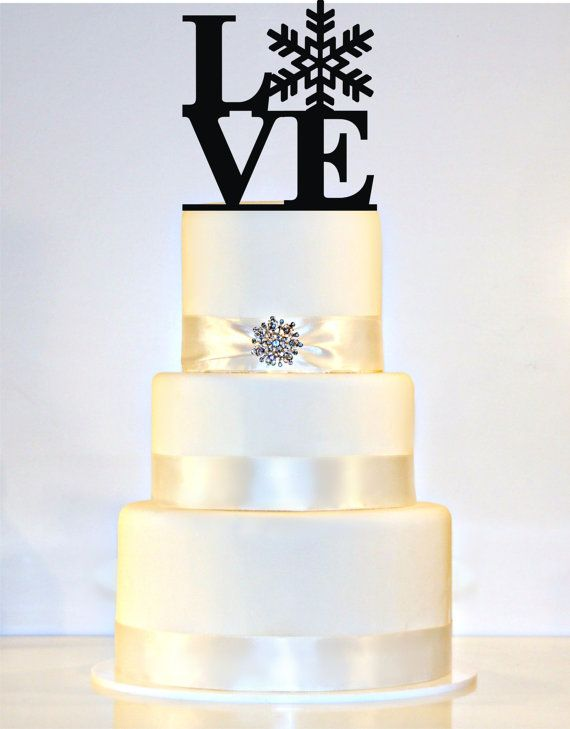 you could use the same ribbon colours as your theme . Maybe get something as topper to match you save the date snowflakes. I must say all the other snowflake cakes I have seen look rubbish :)