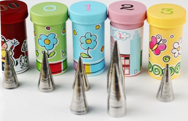 For the bakers out there: DIY Storage Containers for Piping Tips...(Made out of old medicine plastic bottles.)