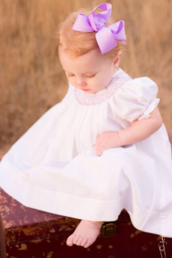 (Reminds me of Maura from The Christmas Calamity) Strawberry blonde baby.  Smocked gown.