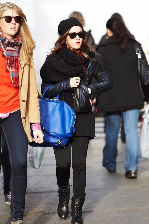 bright blue bag with all-black outfit