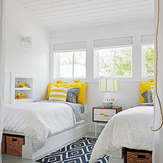 built in bed with storage space underneath, headboard made of pillows fastened to the wall