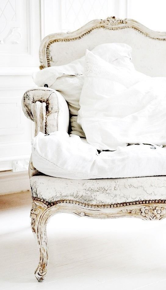 Painted white; including the fabric; could use Chalk Paint® by Annie Sloan.