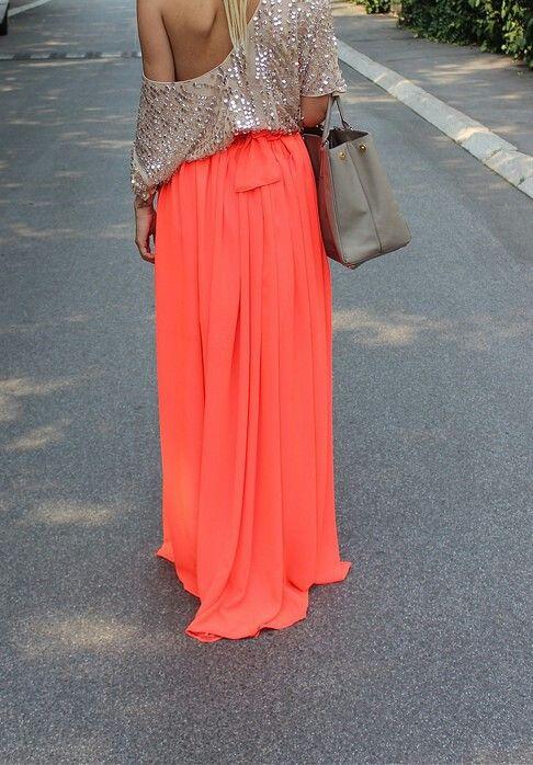 Long orange skirt, beige top, beige handbag