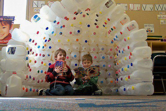 Kids fort made out of empty plastic milk jugs that are hot glued together...