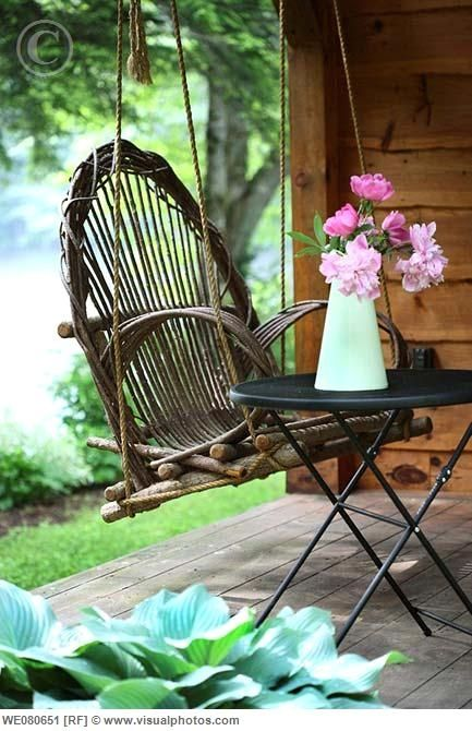 adirondack swing on a porch .....     ....simple and sweet