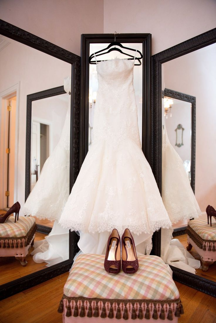 Katie & Kyle's wedding dress and heels laid out for bride. San Patrick Gown by Tre Bella Bridal