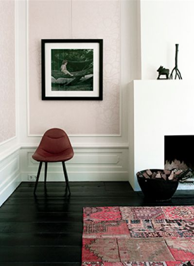 Love the contrasts here: mid-century chair, minimalist fireplace, classic wall molding. Goregous.
