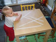The Stay-at-Home-Mom Survival Guide: Many ideas... including Toddler Activities - peeling tape off the table (or fridge) develops fine motor skills (lots of ideas here)