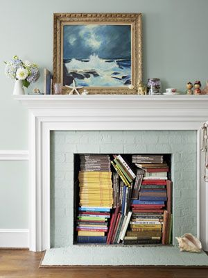 Don't use your fireplace? Don't let the place go to waste, stack collectible books with colorful spines inside.