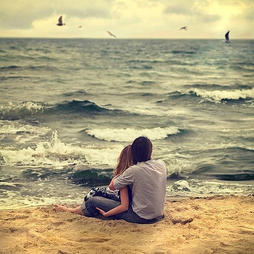Sitting on the beach together...