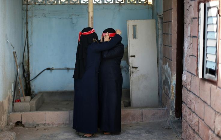 Militanti Palestinesi SI preparano per un'esercitazione, a Gaza.  (Suhaib Salem, Reuters / Contrasto)