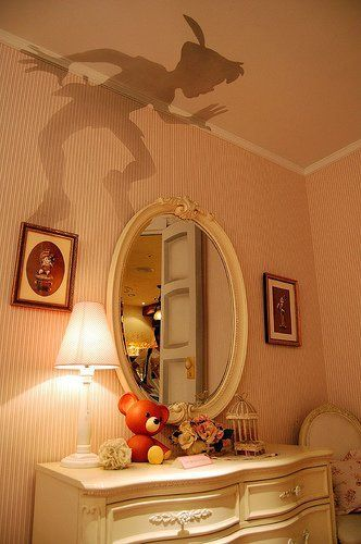 Peter Pan outline, cut out and put on top of lamp shade! freaking awesome!!!!