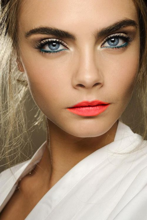 bright lips + and blue-lined eyes