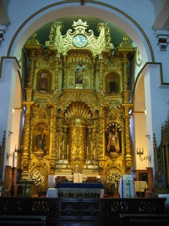 The golden altar inside San Jose Church.  Rumor has it that this is the only valuable to survive