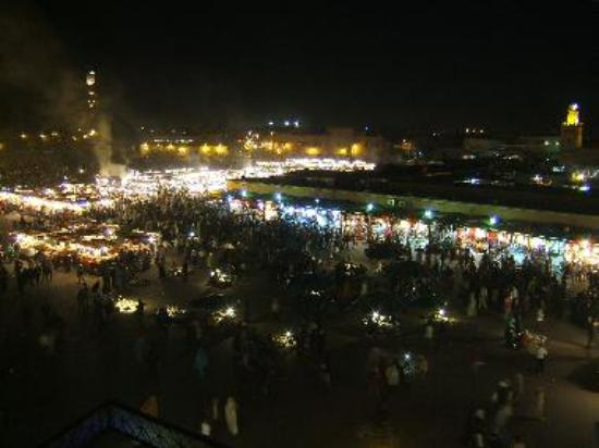 Chaotic Jemaa el Fna and mosques in the evening