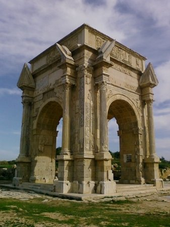 This photo of The Arch of Marcus Aurelius is courtesy of TripAdvisor. According to Girl Solo in Arabia (http://girlsoloinarabia.typepad.com), built in 163 AD in the Greek style, this arch straddles the decumanus maximus and the cardo-maximus in the ancient Roman city of Oea which is now Tripoli. Besides Roman columns re-used in newer buildings in the medina, this is the only existing Roman monument in the city.