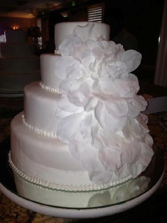 Magnolia Bakery Flowers And Swiss Dot Wedding Cake