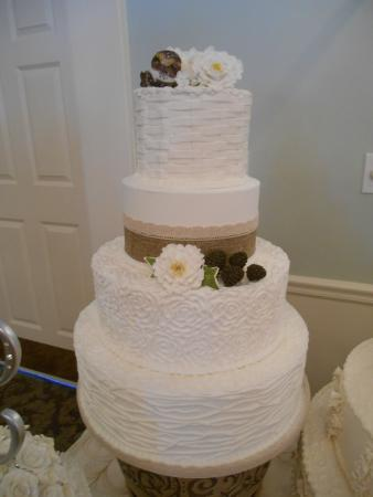 Beautiful 4 Tier Wedding Cake Featuring Mixed Designs And