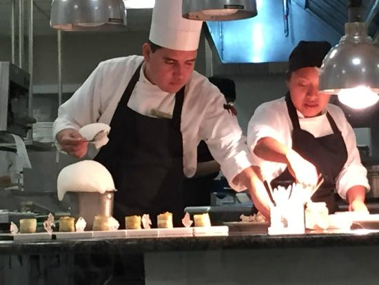 Chefs Table Preparing A Dish With Infused Foam