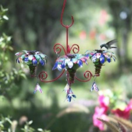Camino Silvestre Flowers Made Out Of Aluminum Juice Cans Adorn This Chandelier Hummingbird Feeder