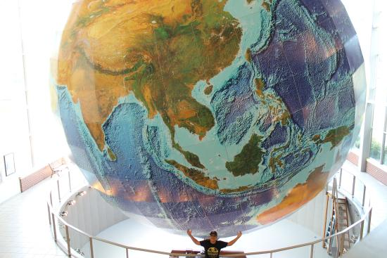 Holding the Globe in his hands   Picture of DeLorme Map Store and     DeLorme Map Store and Company  Holding the Globe in his hands