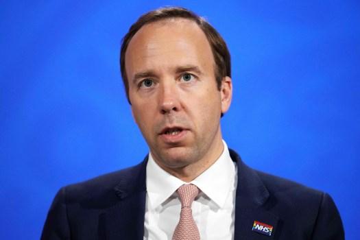 U.K. Health Minister Matt Hancock apologizes over photo of him kissing his top aide 2