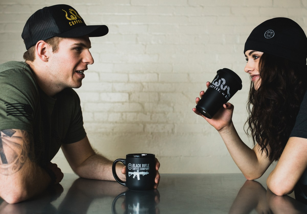 man and woman drinking black rifle coffee