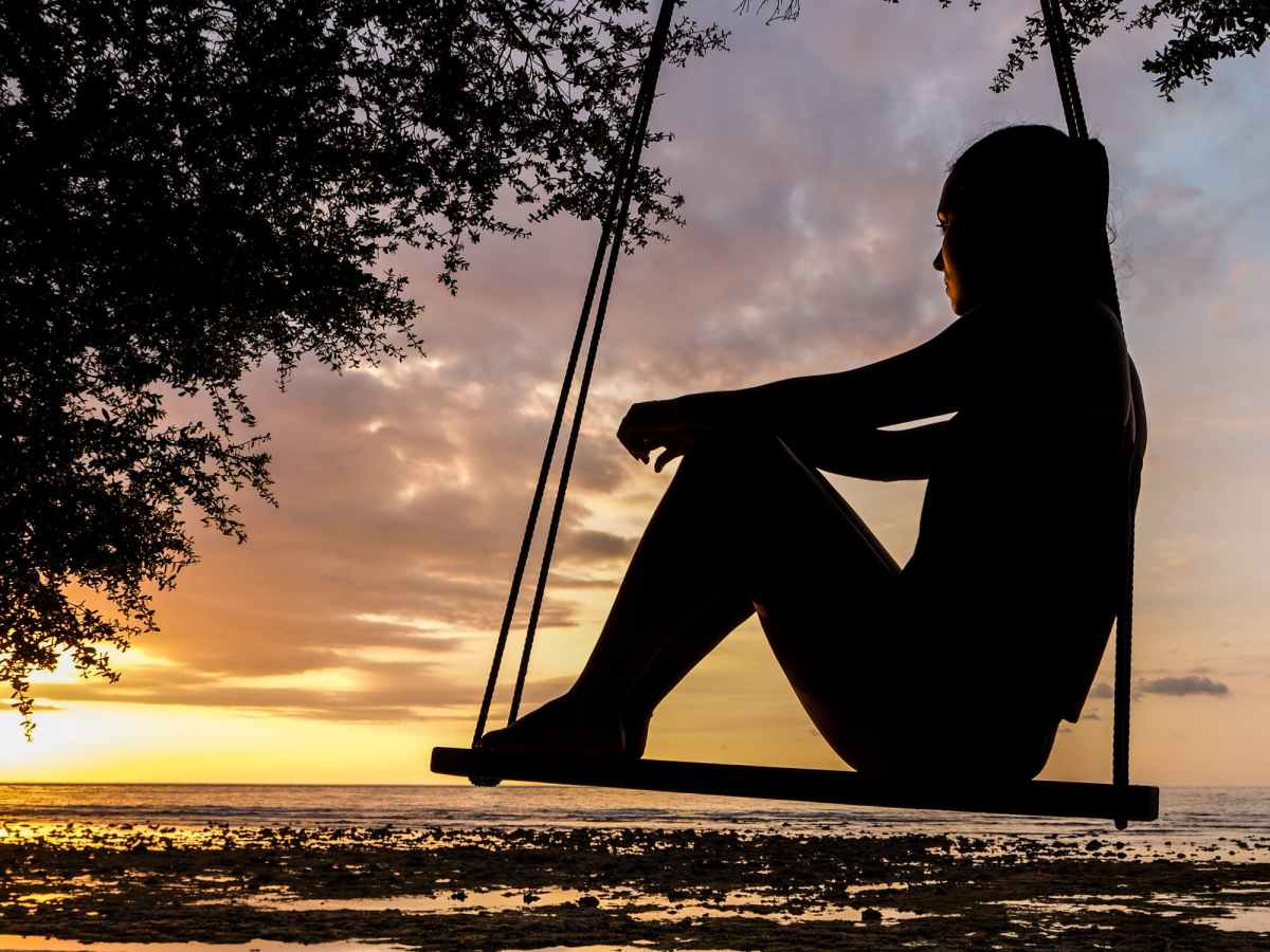 woman rests on swing