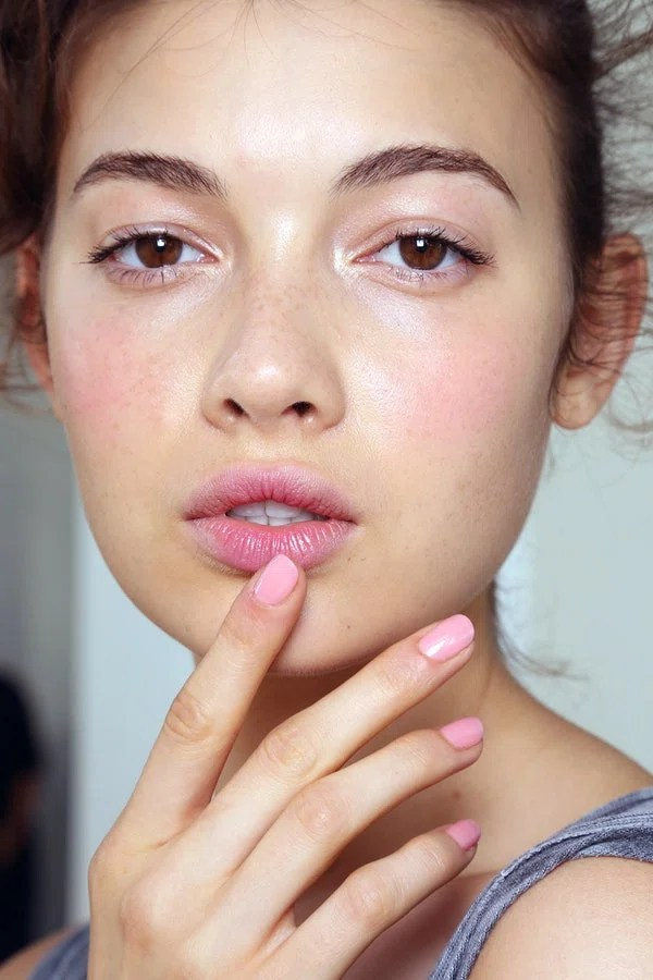 """Here's a challenge: Try to match your makeup to your mani. The monochromatic pink look at Reem Acra embodied the saying """"Go big or go home."""" How lead manicurist Naomi Gonzalez scored this bubblegum shade of pink: She layered ZOYA in Bela over two coats of ZOYA in Barbie."""