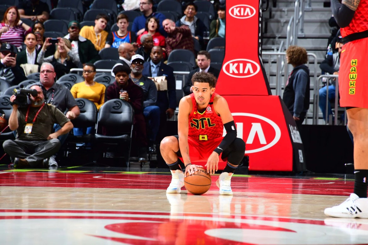 Trae Young #11 of the Atlanta Hawks wears a number 8 jersey to honor the passing of Kobe Bryant during a game against the Washington Wizards on January 26, 2020 at State Farm Arena in Atlanta, Georgia.   (Photo by Scott Cunningham/NBAE via Getty Images)